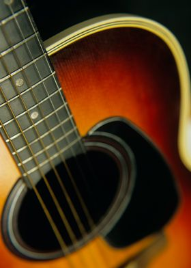 Close up of an acoustic six string Guitar