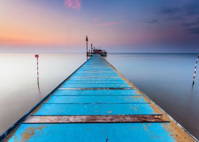 Wooden pier in Lignano Pineta (Italy)