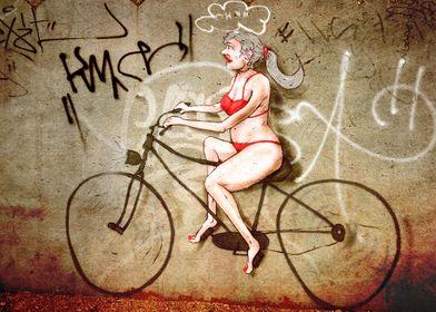 Funny Graffiti of a woman on a bike =)