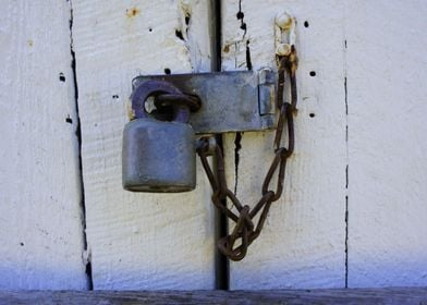 Close up of a rusty lock and chain