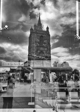 Church reflected in Forum windows, Norwich.