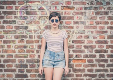 Young hipster girl and wall