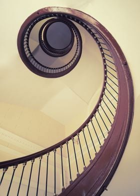 Wooden spiral staircase in pastel tones
