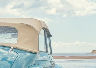 An old classic vintage car at the beach on Prince Edwar ...