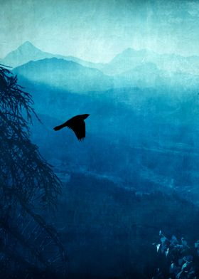 View of Italian alps on a hazy morning with a bird