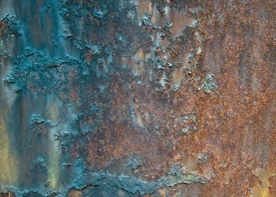 Rusty metal on the side of a car.