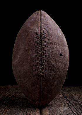 An old vintage leather football under dramatic lighting ...