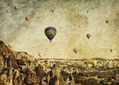 Hot air balloons rising over Cappadocia, Turkey. The su ...