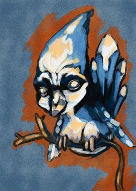 A baby blue bird on a twig