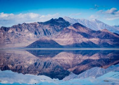 Mountain peaks reflected in the still waters of the Bon ...