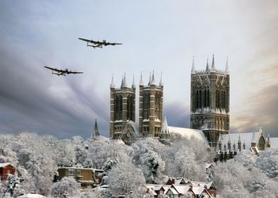 Lancaser Bombera pass over a snow covered Lincoln Cathe ...