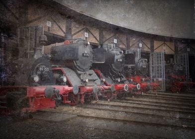 Locomotives on the rails in depot. Old steam trains. He ...
