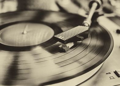 Vinyl record player in sepia.