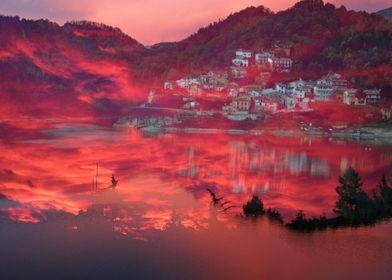 Wonderful pink sunset over beautiful seaside village an ...