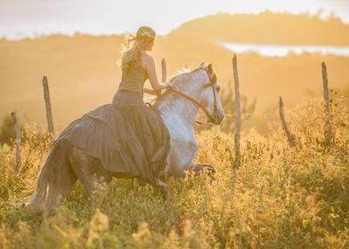 she rides into the Brazil sunset