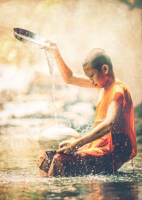 Vintage composition of a boy washing pots in river.