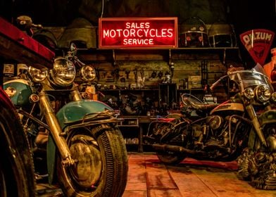 Motorcycles await service in a vintage repair shop