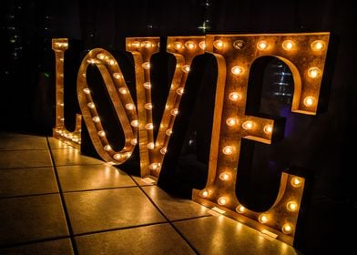 "Industrial letters spell the word ""love"" with glowing e ..."