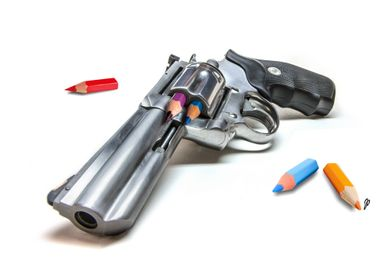 pistol with crayons instead of bullets