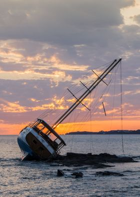 A beautiful sail boat wrecked on the coast