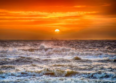 The crashing waves on the Dutch beach at sunset....