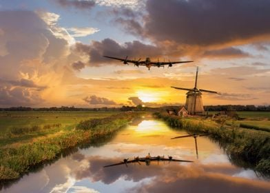 RAvro Lancaster Bomber over the Dutch Windmills