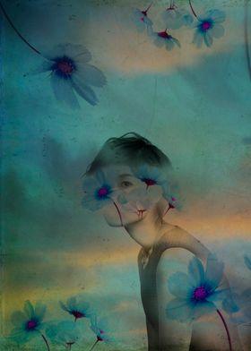Woman hidden in a world of flowers