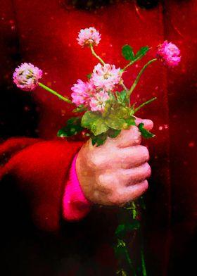 Girl holding wild clover