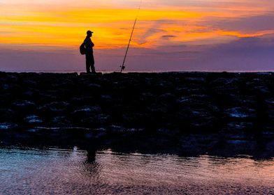 fisherman during sunset