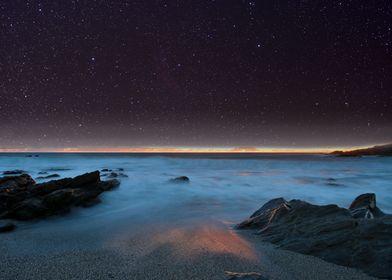 Night sky over the coast