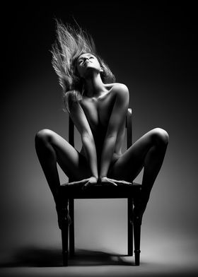 Nude woman on chair