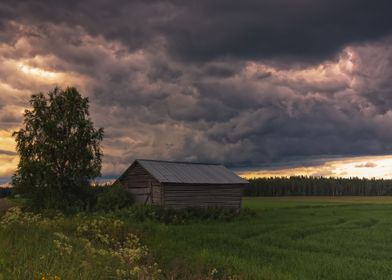 A Barn and Storm Clouds