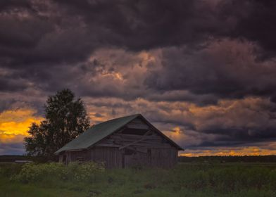 Barn Under Storm Clouds