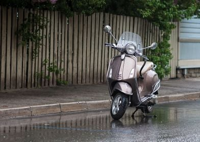 Scooter Parked In The Rain