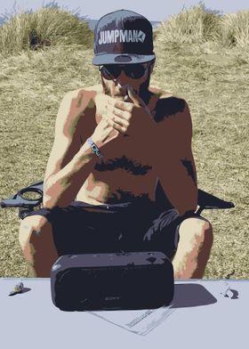 Young Man smoking Camping