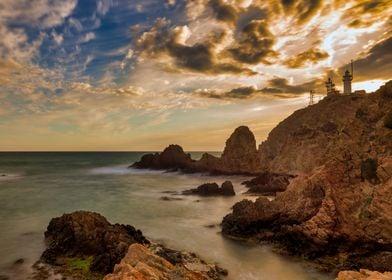 Seascape cliffs lighthouse